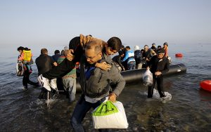 Syrian refugees on an overcrowded dingy land on the Greek island of Kos after crossing part of the Aegean Sea from Turkey to Greece, early May 26, 2015. Hundreds of mainly Syrian and Afghan immigrants on Tuesday landed on the Greek island of Kos in the south-eastern Aegean Sea. REUTERS/Yannis Behrakis TPX IMAGES OF THE DAY - RTX1EK3C